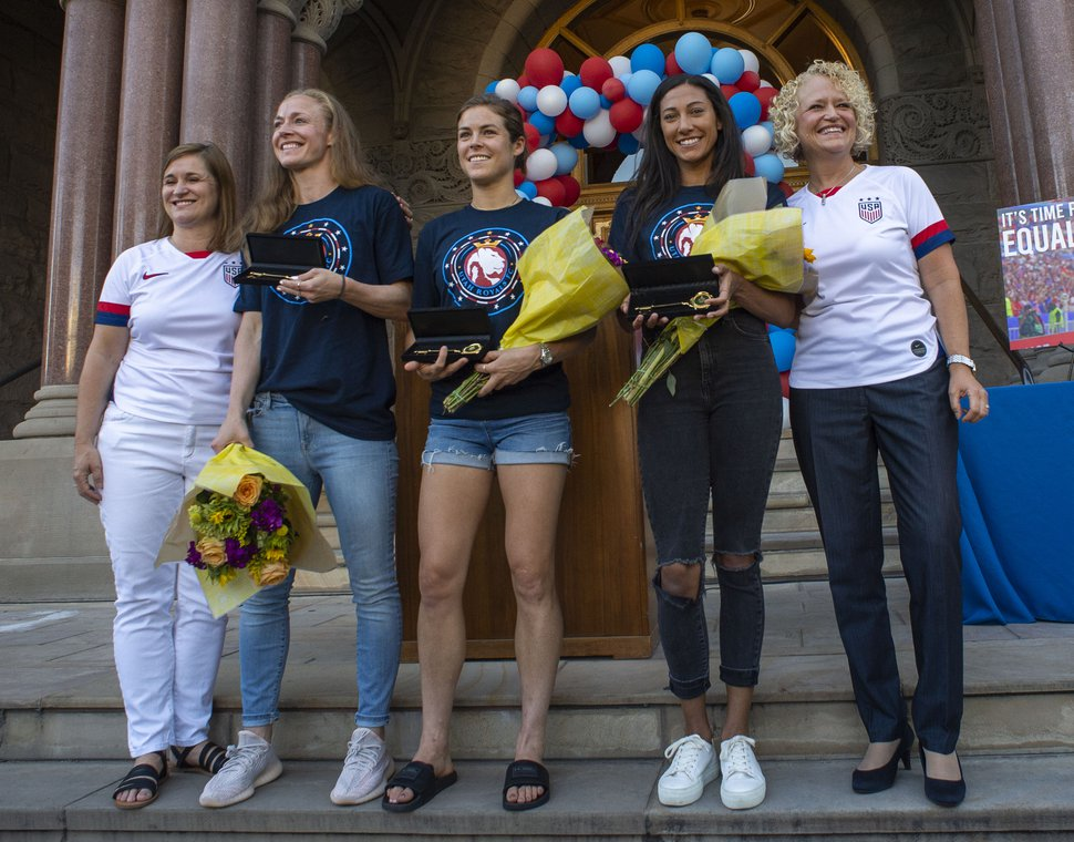 (Rick Egan | Tribune file photo) Salt Lake County Mayor Jenny Wilson and Salt Lake City Mayor, Jackie Biskupskie, pose with Royals FC, and US National Women's soccer team members, Becky Sauerbrunn, Kelley O'Hara, and Christen Press, during a ceremony honoring them for their part in the US National Women's World Cup win, at the City and County Building, Monday, July 22, 2019.