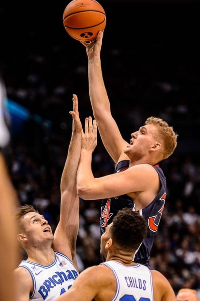 (Trent Nelson | The Salt Lake Tribune) St. Mary's Gaels center Jock Landale (34) shoots over Brigham Young Cougars forward Luke Worthington (41) as BYU hosts the St. Mary's Gaels, NCAA basketball in Provo, Saturday December 30, 2017.