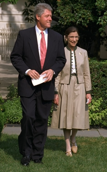 President Clinton and Judge Ruth Bader Ginsburg walk to the Rose Garden of the White House Tuesday August 3, 1993 to meet with reporters. Earlier, the Senate voted 96-3 to confirm Ginsburg to the Supreme Court, making her the second woman to serve on the high court. (AP Photo/Ron Edmonds)