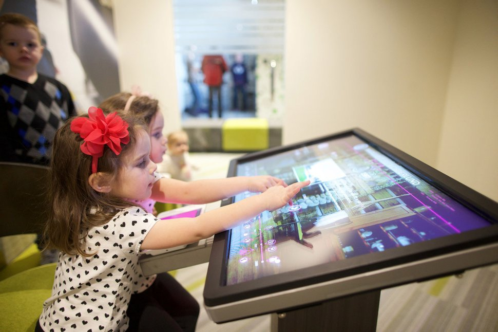 | courtesy LDS Church Children play with an interactive screen at the Family History Library's new interactive discovery experiences. The attraction opens on Temple Square Wednesday, February 8, 2017.