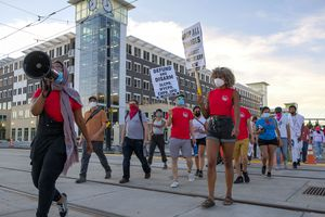 (Leah Hogsten  |  The Salt Lake Tribune) Protesters walk from the West Valley Police Department during the People's Council rally to defund the police force, Aug.8, 2020.  Saturday's rally was hosted by the Salt Lake chapter of the Party for Socialism and Liberation.