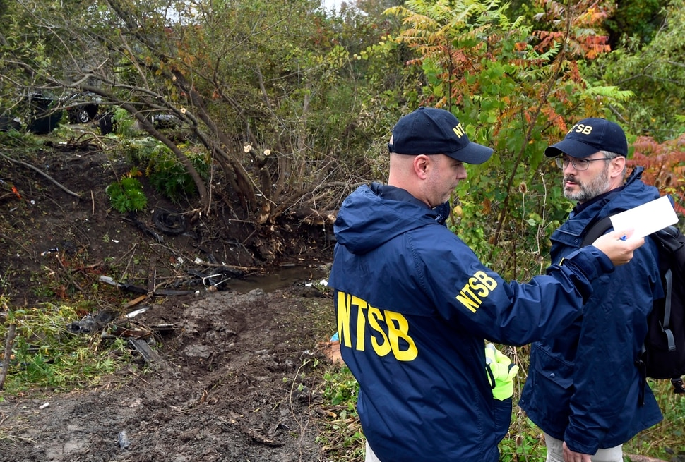 (AP Photo/Hans Pennink) Members of the National Transportation Safety Board work at the scene of yesterday's fatal crash, in Schoharie, N.Y., Sunday, Oct. 7, 2018.