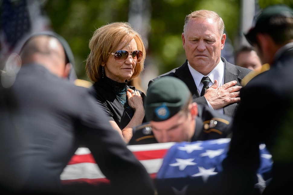 (Trent Nelson | The Salt Lake Tribune) Laura and Randy Butler at the graveside service for their son, fallen soldier Aaron Butler, in Monticello Saturday August 26, 2017.