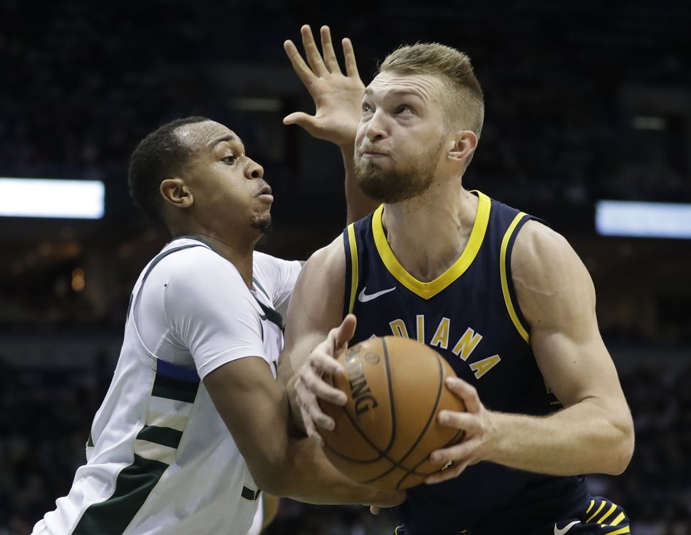 RETRANSMISSION TO CORRECT ID TO JOHN HENSON - Indiana Pacers' Domantas Sabonis, right, tries to drive past Milwaukee Bucks' John Henson during the first half of an NBA basketball game Wednesday, Jan. 3, 2018, in Milwaukee. (AP Photo/Morry Gash)