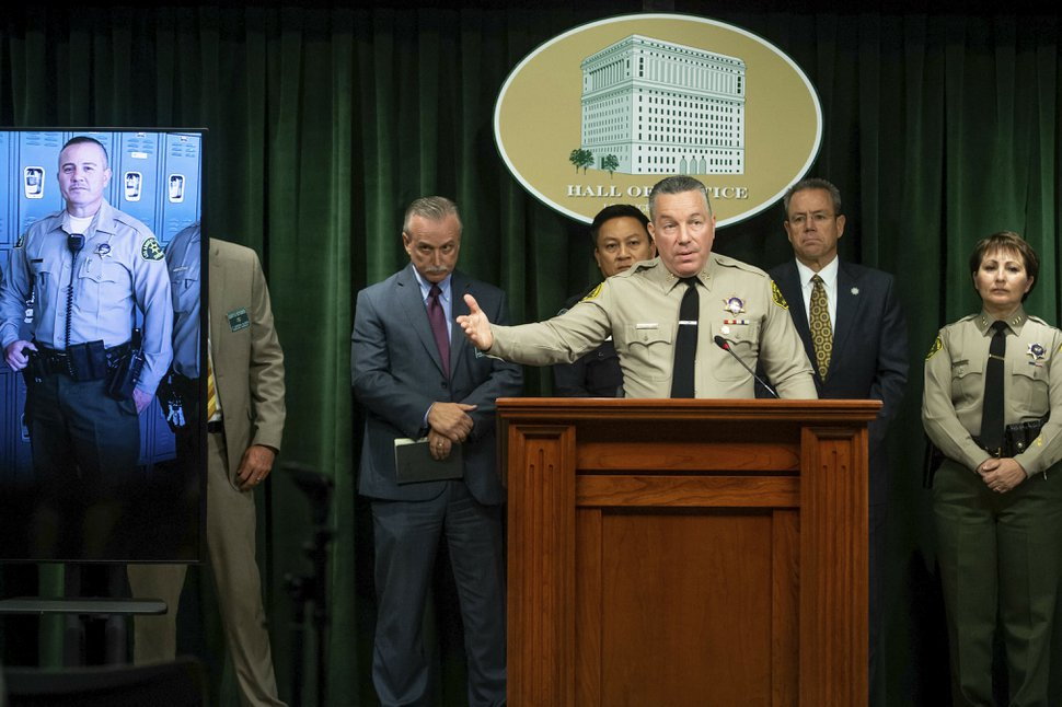 (Sarah Reingewirtz | The Orange County Register via AP) Los Angeles County Sheriff Alex Villanueva speaks during a news conference in Los Angeles on Tuesday, June 11, 2019. Rhett Nelson, 30, of St. George, Utah, was arrested Tuesday on suspicion of shooting an off-duty Los Angeles County sheriff's deputy at a fast-food restaurant Monday, and authorities say they are investigating whether he may have killed another man an hour earlier in attacks that both appear to be random.