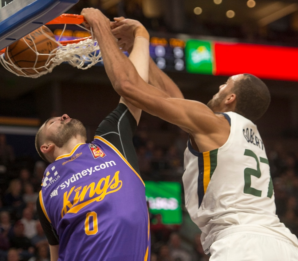 (Rick Egan | The Salt Lake Tribune) Utah Jazz center Rudy Gobert (27) dunks the ball over Sydney Kings guard Isaac Humphries (0), in preseason basketball Utah Jazz vs.Sydney Kings, in Salt Lake City, Sunday, October 2, 2017.