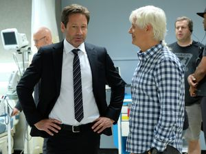 """(Photo courtesy of Robert Falconer/Fox) David Duchovny — shown with executive producer Chris Carter behind the scenes of """"The X-Files"""" — will play a Mormon in the Showtime series being adapted from the actor's latest novel."""
