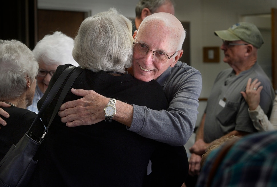 (Scott Sommerdorf | The Salt Lake Tribune) Robert Bob Sweet of Pennsylvania hugs one of his newfound cousins as the families gathered for a reunion, Thursday, November 9, 2017 at the Bountiful Tabernacle.