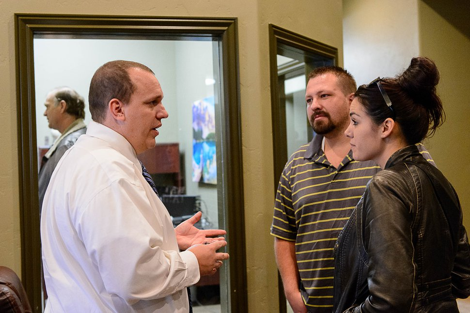 Trent Nelson | The Salt Lake Tribune Shawn and Alexandra Stubbs, right, speak with United Effort Plan executive director Jeff Barlow about at a Hildale home owned by the UEP trust that they hope to move into, Saturday February 11, 2017.