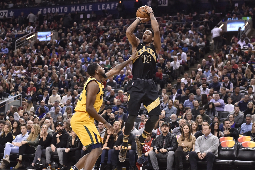 Toronto Raptors guard DeMar DeRozan (10) shoots over Utah Jazz forward Royce O'Neale during the second half of an NBA basketball game Friday, Jan. 26, 2018, in Toronto. (Frank Gunn/The Canadian Press via AP)