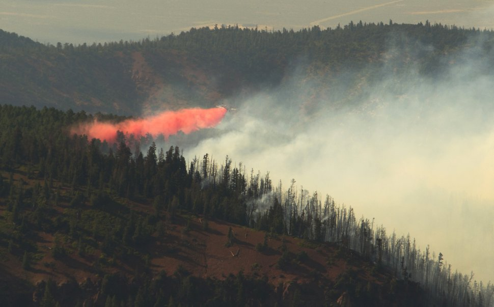 Rick Egan | The Salt Lake Tribune A plane drops fire retardant on the Brian Head Fire as it continued to burn north of the southern Utah ski town of Brian Head, Wednesday, June 21, 2017.