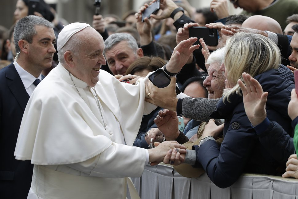 (Alessandra Tarantino | AP) Pope Francis salutes faithful in St. Peter's Square at the Vatican before leaving after his weekly general audience, Wednesday, Feb. 26, 2020.