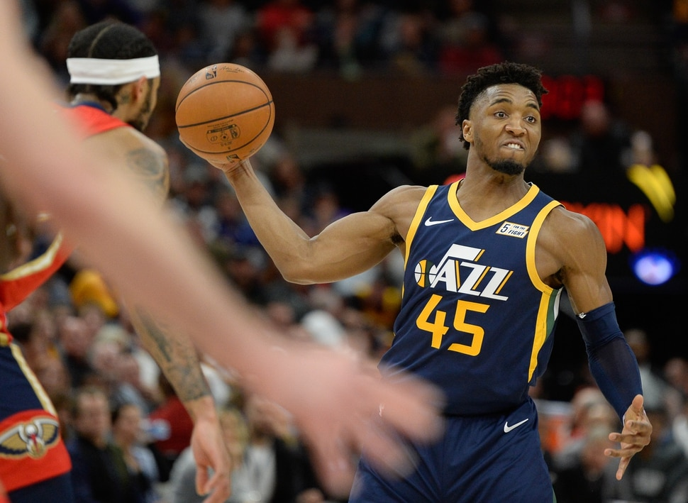 (Francisco Kjolseth | The Salt Lake Tribune) Utah Jazz guard Donovan Mitchell (45) passes the ball to a teammate as the Utah Jazz host the New Orleans Pelicans in their NBA basketball game at Vivint Smart Home Arena in Salt Lake City on Sat. Nov. 23, 2019.