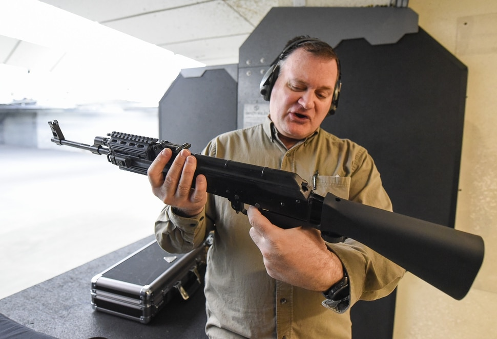 (Francisco Kjolseth | The Salt Lake Tribune) Utah gun rights advocate Clark Aposhian, one of only a handful of Americans who are legally allowed to keep their bump stock, a shooting accessory that alters semi-automatic rifles to fire in quick bursts like a machine gun, demonstrates how it works on an AKM-47 at a gun range in Murray, UT, on Thursday, April 4, 2019. He is challenging the bump stock ban in court, and an appeals court has allowed him to keep his bump stock until his case is resolved in court.