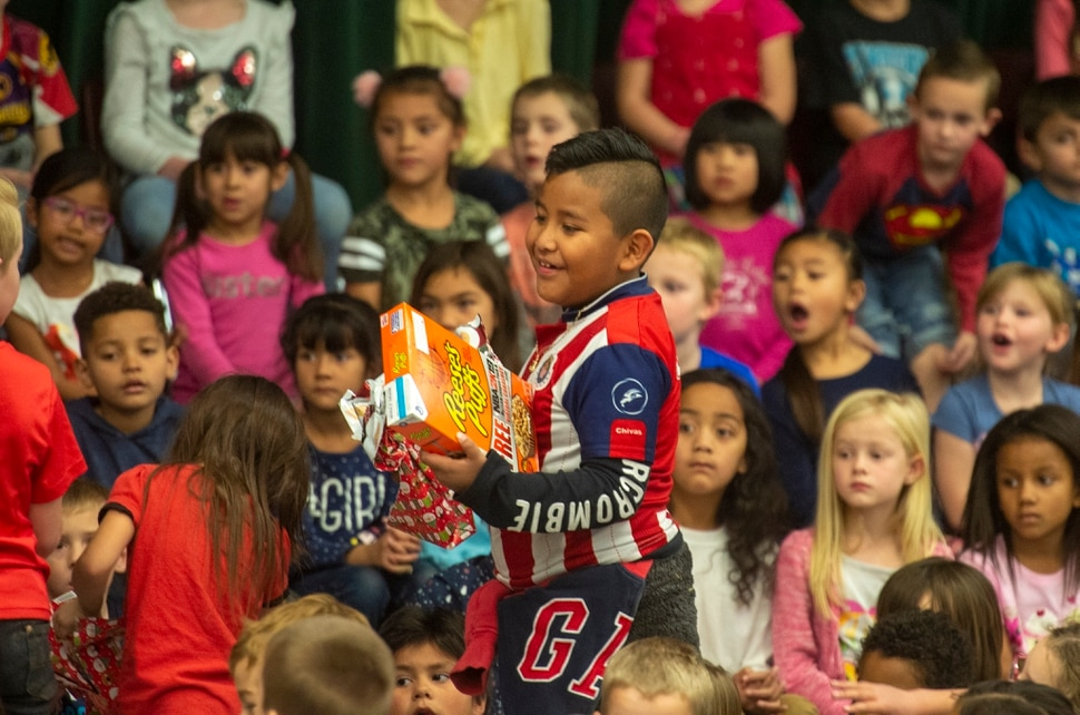 (Rick Egan | The Salt Lake Tribune) First grade student, Hared Macedo smiles with his box of cereal. Ms. Worthington the principal, surprised all 650 students at her school with the gift-wrapped boxes of cereal, at Oquirrh Elementary in West Jordan, Thursday, Dec. 20, 2018.