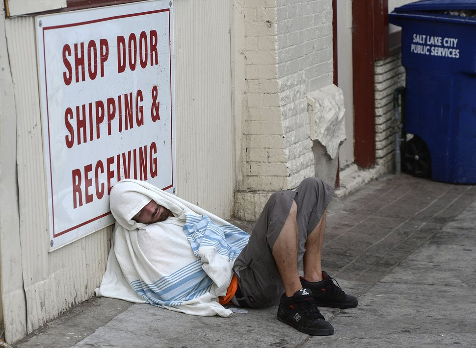 Al Hartmann | The Salt Lake Tribune Man sleeps on sidewalk near 200 S. and 500 W. Wednesday morning July 19.