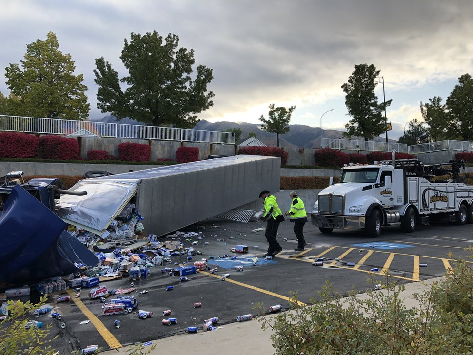 (Courtesy of FOX 13 News) A semitrailer carrying a haul of Bud Light beer overturned in a parking lot of a Latter-day Saint meetinghouse in Sandy on Thursday, Oct. 10, 2019.