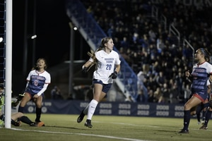 (Photo courtesy of BYU Athletics) BYU's Cameron Tucker moves to clear the ball during a recent Cougar women's soccer game.