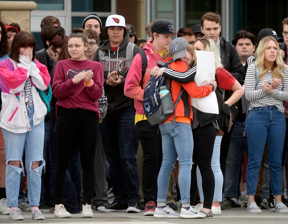 (Al Hartmann | The Salt Lake Tribune) About 80 students at Westlake High School in Saratoga Springs left class and stood together in silence at the front entrance of the school Wednesday March 14, 2018 to remember the 17 students who died in a school shooting in Florida. They held posters of the names of those killed.