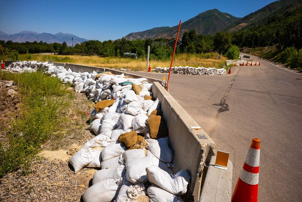 (Trent Nelson | The Salt Lake Tribune) Sandbags and barriers in Woodland Hills on Thursday Aug. 15, 2019.