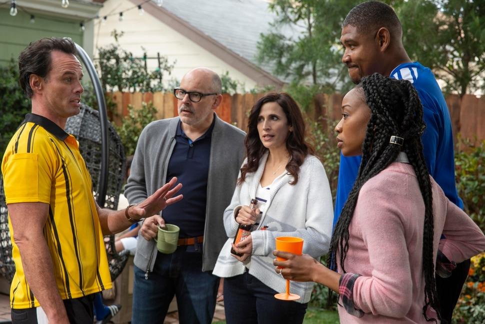 "(Photo courtesy Michael Yarish/CBS) Walton Goggins (left), Rob Corddry, Michaela Watkins, Omar Benson and Maya Lynne Robinson star in ""The Unicorn."""