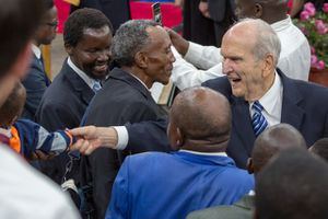 (Photo courtesy LDS Church) LDS Church President Russell M. Nelson wades into a crowd of Mormon well-wishers to shake hands Thursday in Nairobi, Kenya.