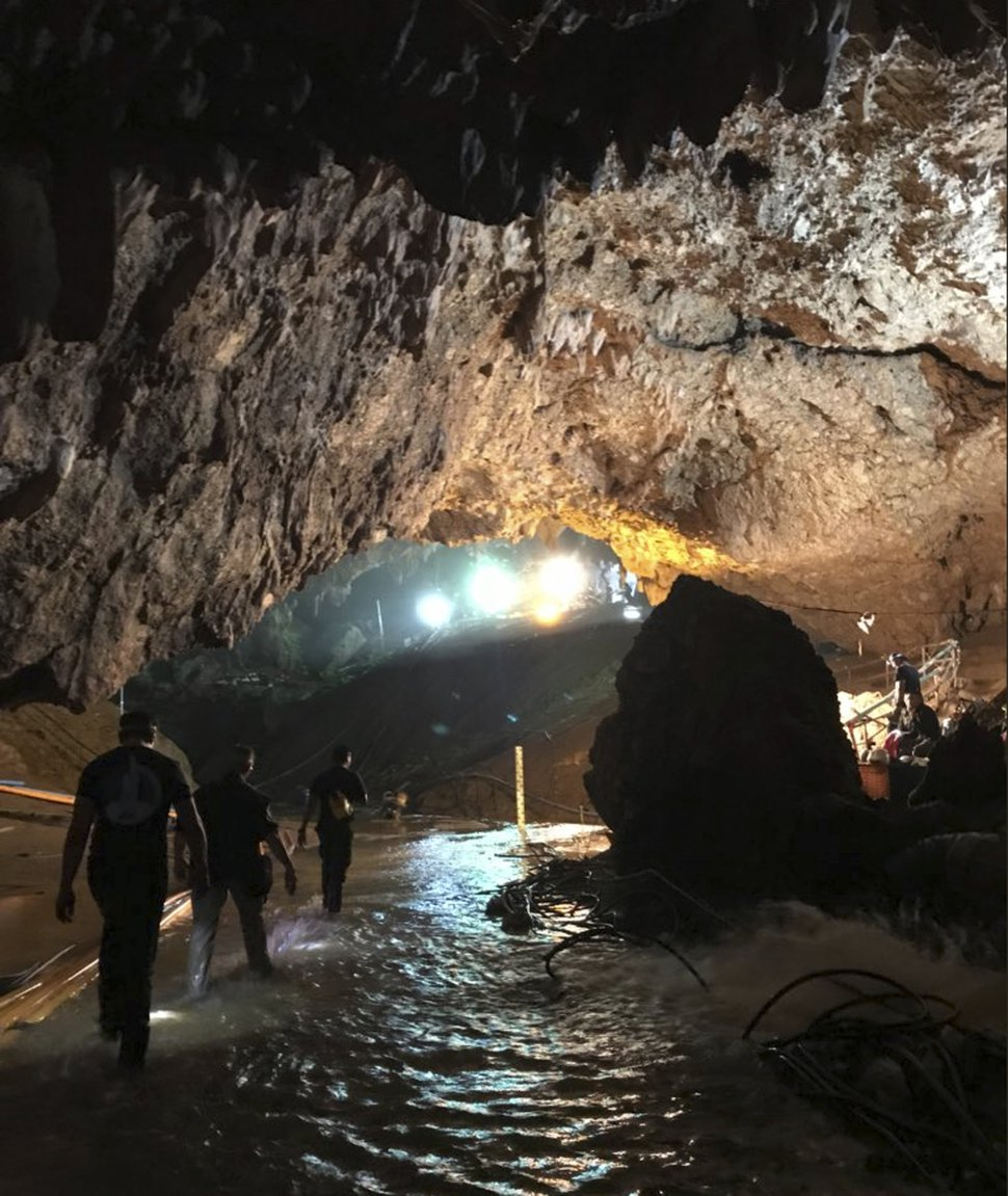 This photo tweeted by Elon Musk shows efforts underway to rescue trapped members of a youth soccer team from a flooded cave in northern Thailand. Musk tweeted early Tuesday, July 10, 2018, he has visited the cave and has left a mini-submarine there for future use. (Courtesy of Elon Musk via AP)