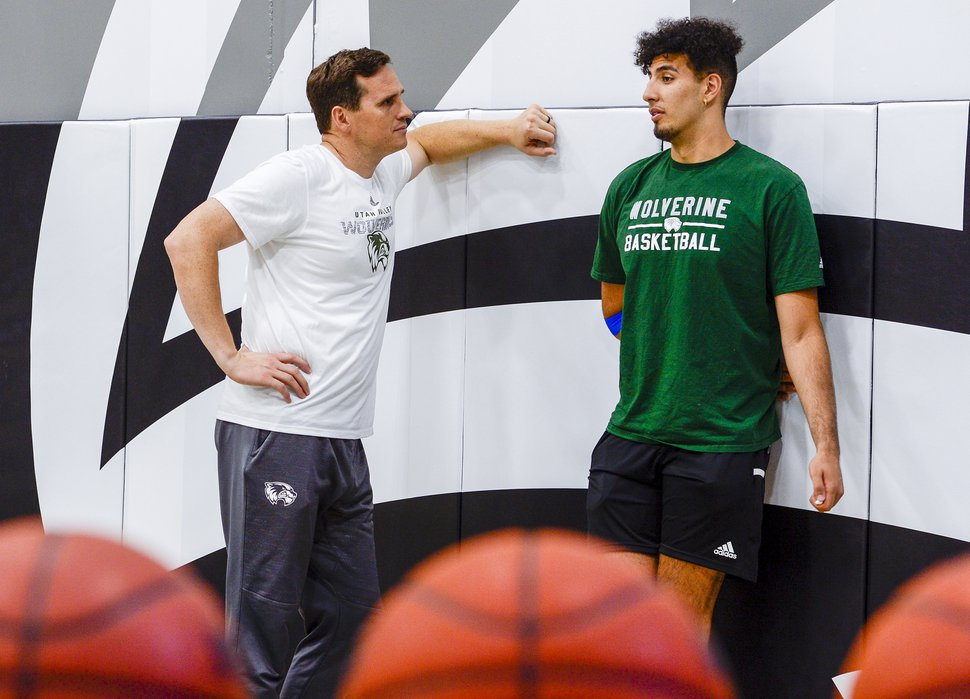 (Leah Hogsten | The Salt Lake Tribune) Utah Valley University basketball coach Mark Madsen talks with UVU forward Fardaws Aimaq inside the NUVI Basketball Center on Monday, July 1, 2019.