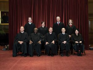 (Erin Schaff | The New York Times) Members of the Supreme Court pose for a group photo at the Supreme Court in Washington, April 23, 2021.