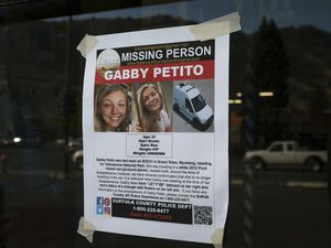 (Amber Baesler   AP Photo) This Thursday, Sept. 16, 2021, photo, shows a Suffolk County Police Department missing person poster for Gabby Petito posted in Jakson, Wyo. Petito, 22, vanished while on a cross-country trip in a converted camper van with her boyfriend. Authorities say a body discovered Sunday, Sept. 19 in Wyoming, is believed to be Petito.
