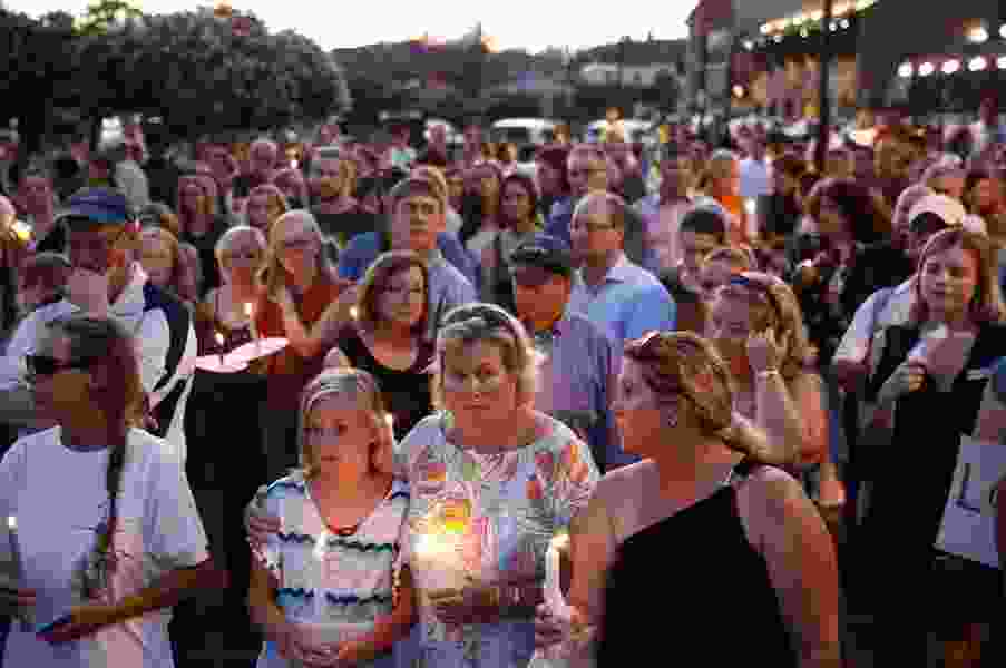 Grief in small town: March honors victims of newsroom attack
