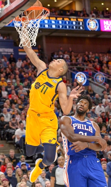 Leah Hogsten | The Salt Lake Tribune Utah Jazz guard Dante Exum (11) dunks on Philadelphia 76ers center Joel Embiid (21) as the Utah Jazz host the Philadelphia 76ers at Vivint Smart Home Arena, Thursday, December 27, 2018.