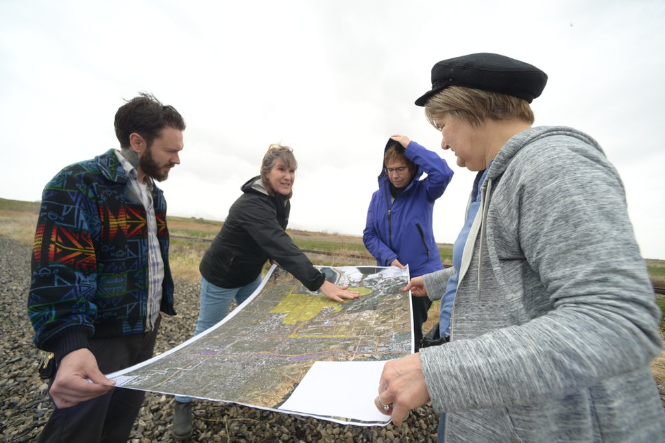 (Leah Hogsten | Tribune file photo) From left, Michael Cundick, co-founder of Salt Lake City Air Protectors; Deeda Seed with the Center for Biological Diversity; Heather Dove president of the Great Salt Lake Audubon; and Dorothy Owen, chairwoman of the Westpointe Community Council, discuss the location of the proposed inland port on April 2, 2019. Last year, Utah lawmakers took control of a massive portion of land in Salt Lake City's northwest area in an effort to create a distribution hub on the city's northwest side, sparking outrage among residents.