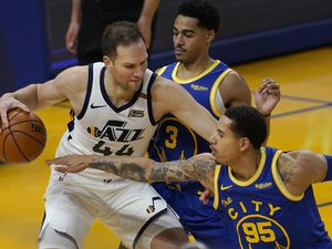 (Jeff Chiu | AP) Utah Jazz forward Bojan Bogdanovic (44) is defended by Golden State Warriors forward Juan Toscano-Anderson (95) and guard Jordan Poole (3) during the first half of an NBA basketball game in San Francisco, Sunday, March 14, 2021.