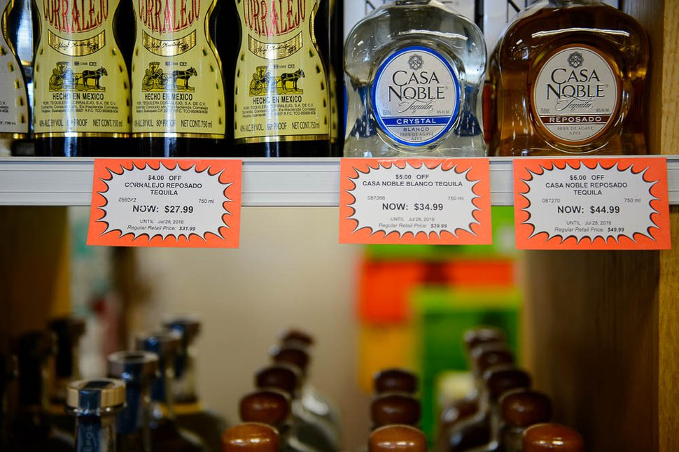 (Trent Nelson | The Salt Lake Tribune) Sale labels on product at Utah state liquor store in Murray, Wednesday July 18, 2018.
