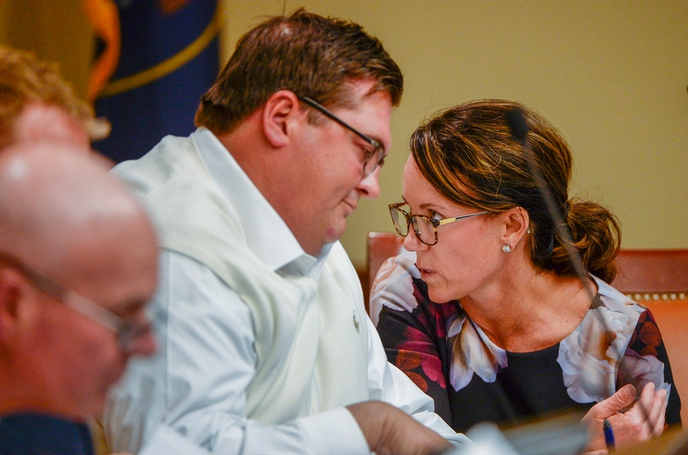 Leah Hogsten | The Salt Lake Tribune l-r Inland Port Authority board members Francis Gibson and Nicole Cottle confer during a board meeting, Sept. 26, 2018. Before the Inland Port board met Wednesday, a coalition of community, environmental and civic organizations have raised a separate transparency issue, noting that the group's proposed half-page budget lacks specificity. The coalition wants to see the board acknowledge concern within the community, provide more details about its budget and fund an investigation into potential environmental harms from development of the port.