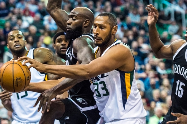 Chris Detrick | The Salt Lake Tribune Brooklyn Nets forward Quincy Acy (13) and Utah Jazz center Boris Diaw (33) go for the ball during the game at Vivint Smart Home Arena Friday March 3, 2017. Utah Jazz defeated Brooklyn Nets 112-97.