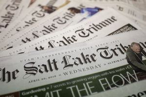 FILE - Copies of The Salt Lake Tribune newspaper are shown on April 20, 2016, 2020, in Salt Lake City. The Salt Lake Tribune will stop printing a daily newspaper after nearly 150 years at the end of the year and move to a weekly print edition. The newspaper reported Monday, Oct. 26, 2020, the change won't result in cuts to the newsroom staff, but nearly 160 people involved with printing and delivering the daily paper will be laid off. (AP Photo/Rick Bowmer, File)
