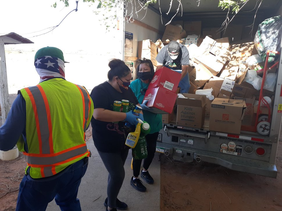 (Courtesy of Louis Williams) Volunteers with Heat Diné Homes organize donated goods for relief efforts on the Navajo Nation.