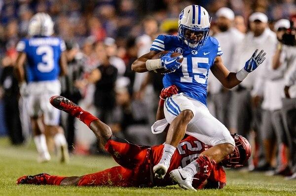 (Trent Nelson | The Salt Lake Tribune) Utah Utes defensive back Javelin Guidry (28) brings down Brigham Young Cougars wide receiver Aleva Hifo (15) as BYU hosts Utah, NCAA football in Provo, Saturday September 9, 2017.