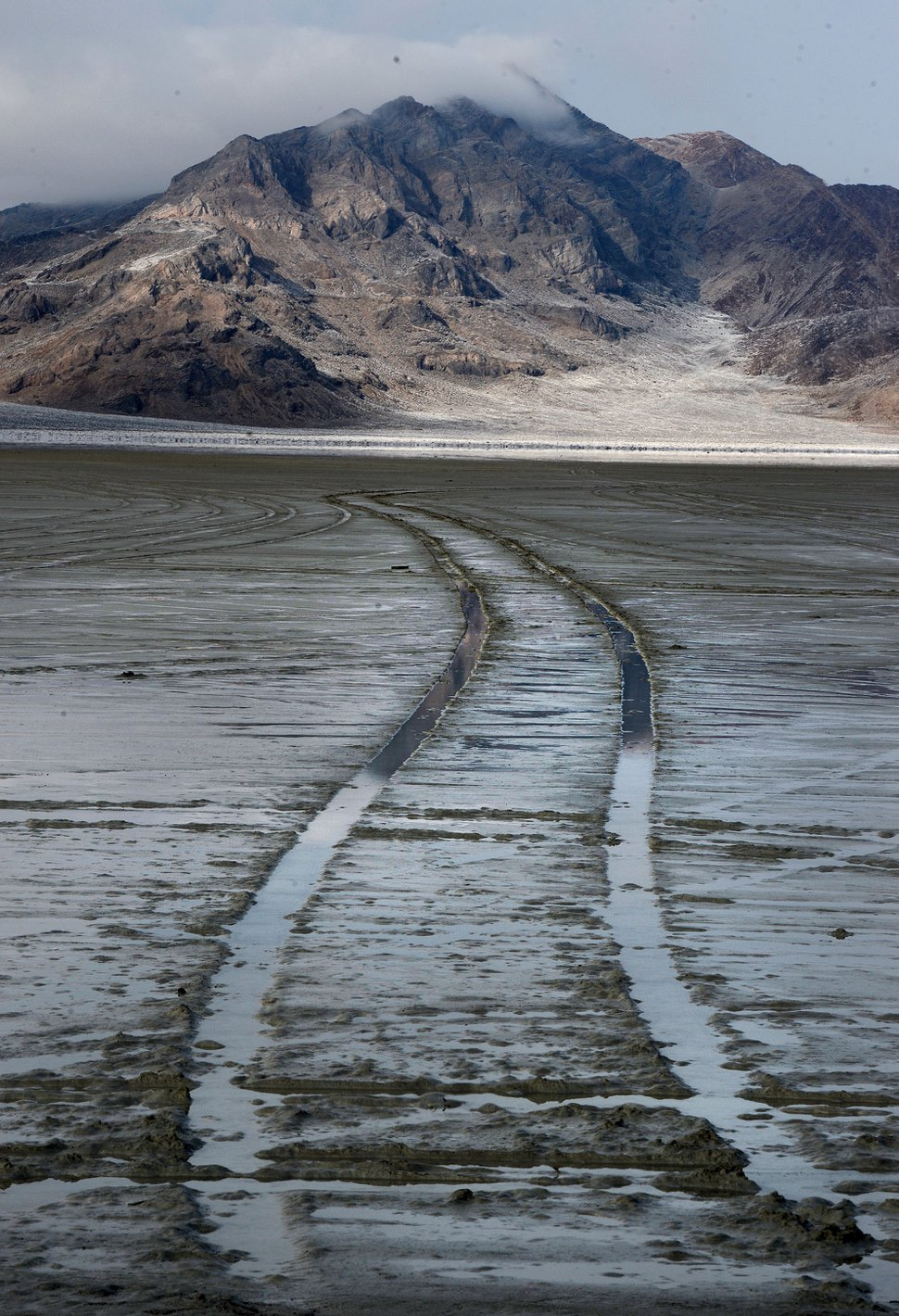 Steve Griffin / The Salt Lake Tribune Car tracks in the mud at the end of the road at Bonneville Salt Flats International Speedway Monday January 2, 2017.