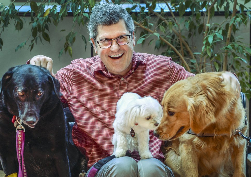 (Leah Hogsten | The Salt Lake Tribune) Vaughn Maurice is the Humane SocietyÕs new executive director, June 5, 2019. Maurice poses for a photo with his dog Nadia, Finn and Dodger.