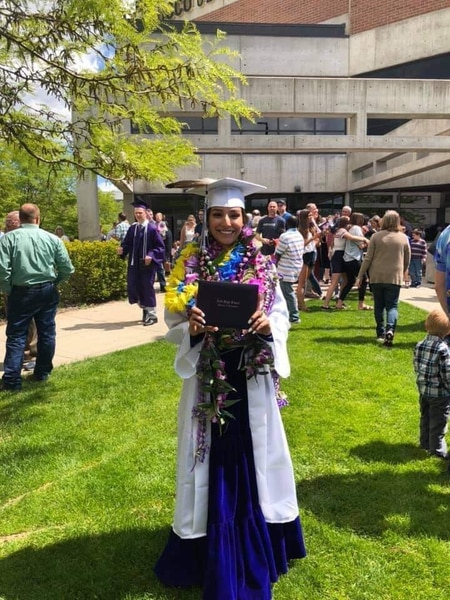(Photo courtesy of Tasheena Savala) Pictured is Tasheena Savala with leis and decorations added after her graduation ceremony on May 29, 2019.