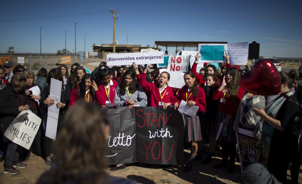 (Ivan Pierre Aguirre via AP) In this Nov. 15, 2018 photo provided by Ivan Pierre Aguirre, students from a local Catholic school protest outside the Tornillo detention camp holding more than 2,300 migrant teens in Tornillo, Texas. The Trump administration announced in June 2018 that it would open the temporary shelter for up to 360 migrant children in this isolated corner of the Texas desert. Less than six months later, the facility has expanded into a detention camp holding thousands of teenagers - and it shows every sign of becoming more permanent.