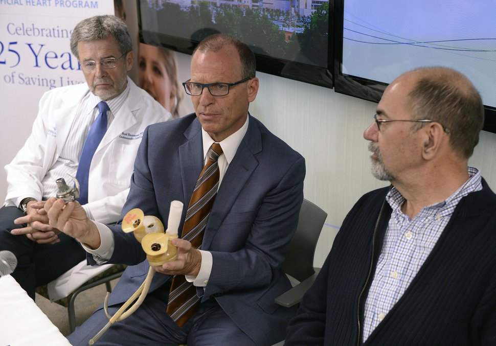 (Al Hartmann | The Salt Lake Tribune) Physicians Brad Rasmusson, medical director for Intermountain Medical Center's Artificial Heart Program, left; Bruce Reid, mechanical circulatory support surgical director; patient Brent Haupt, who received a total artificial heart; and patient Hannah Schramm, who received an assistive heart device, all spoke at a news conference in Murray on Tuesday. Patients, families and doctors reunited to celebrate a major Utah medical milestone: the 25th anniversary of the pioneering Intermountain Artificial Heart Program at Intermountain Medical Center, which has implanted more than 600 life-saving total artificial hearts and heart-assist devices.