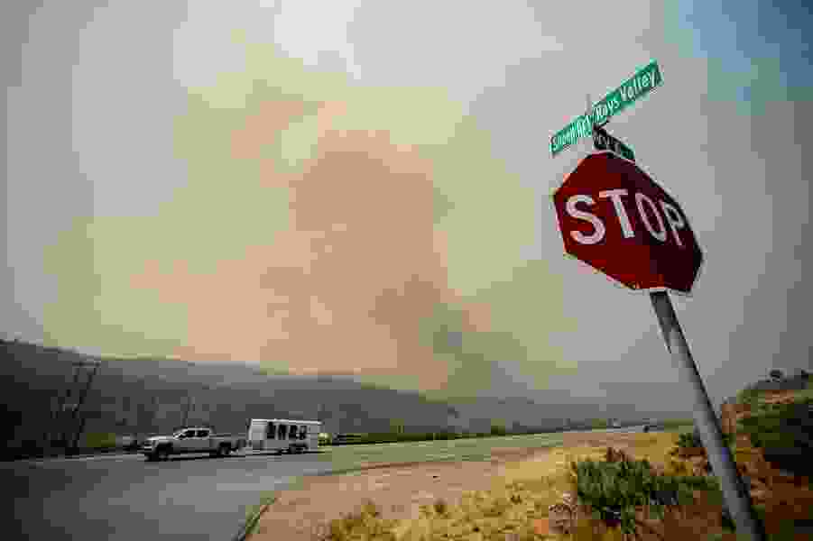 U.S. Highway 6 has reopened after a wildfire jumped the road in southern Utah County