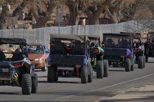 (Leah Hogsten | The Salt Lake Tribune) Several off-road utility terrain vehicles (UTVs) motor up Sand Flats Road toward the Sand Flats Recreation Area trail, located near downtown Moab, Feb. 19, 2021.