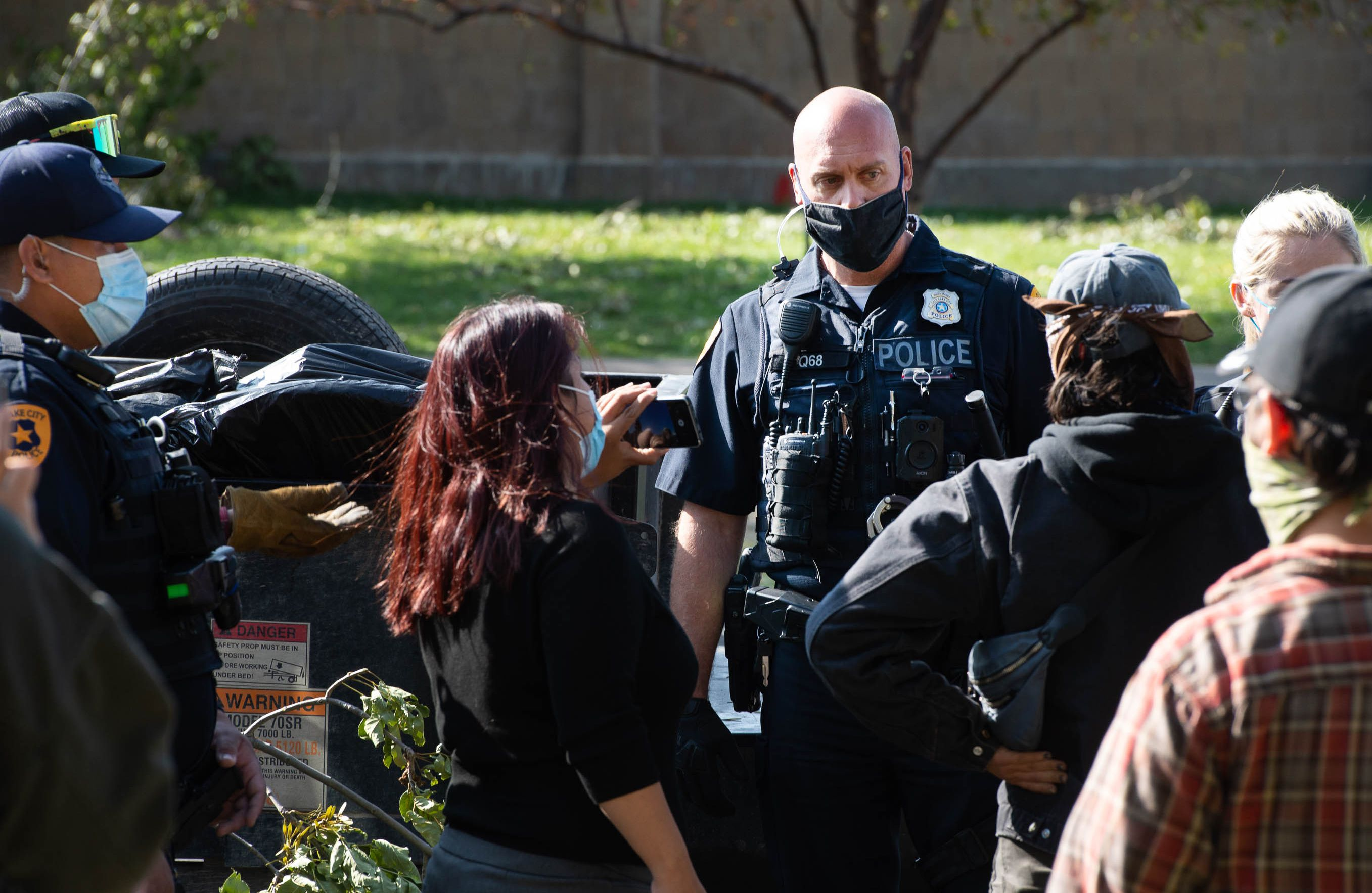 (Francisco Kjolseth  |  The Salt Lake Tribune) Police are confronted by homeless advocates as the Salt Lake County Health Department forces a clean up of homeless camps set up near Taufer Park in Salt Lake City on Thursday, Sept. 10, 2020.