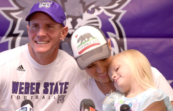Leah Hogsten | The Salt Lake Tribune Sara Hill hugs her daughter Allie, 5, after she and her husband, Weber State football coach Jay Hill, talked about her battle with Hodgkins lymphoma and how the Wildcat family has rallied around her and her husband at Stewart Stadium, Wednesday, August 24, 2016. Weber State football players, coaches and family and friends shaved their heads in support of her chemotherapy treatments.