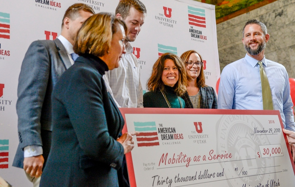 Leah Hogsten | The Salt Lake Tribune Members of the Mobility as a Service or MaaS team share a laugh with University of Utah president Ruth Watkins. MaaS is one of three team finalists in American Dream Ideas Challenge, announced Nov. 28, 2018. Each team will receive $30,000 to use in refining its idea and present its idea for the national round of competition. University of Utah's advisory board, including President Ruth Watkins and Lt. Governor Spencer Cox, selected the finalists. The statewide competition contained 152 entries, all vying for the best idea of how to boost Utahns' net income for 10,000 of the stateÕs middle-class households by 10 percent by 2020 by cutting transportation costs, leveraging unused storage space and revitalizing economically depressed areas of the state.